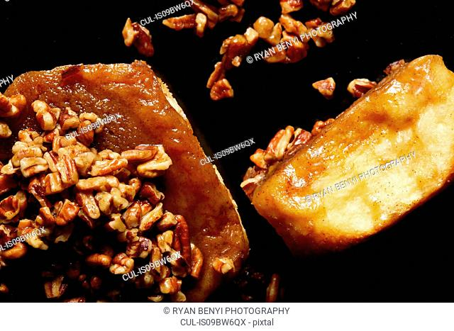 Sticky bun with nuts, close up, overhead view