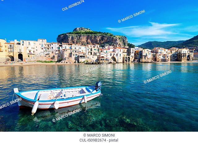 Fisherman's boat near old town waterfront and La rocca, Cefalu, Sicily, Italy