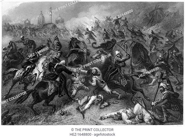 'Havelock's column attacking the mutineers before Cawnpore', 1857, (c1860). British military commander Henry Havelock leading his troops against the Indians...