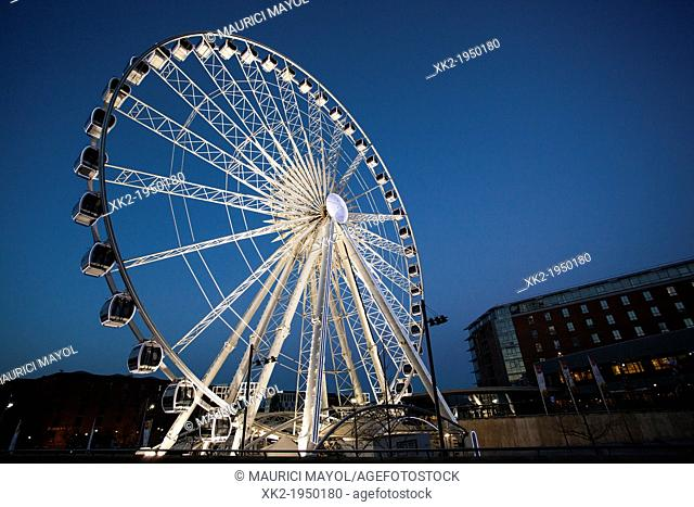 Ferris wheel at night near harbour, Liverpool UK