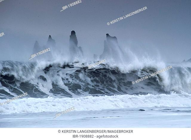 The Reynisdrangar pinnacles between by strong waves on the wintry Reynisfjara beach at Vik I Myrdal, Iceland, Europe