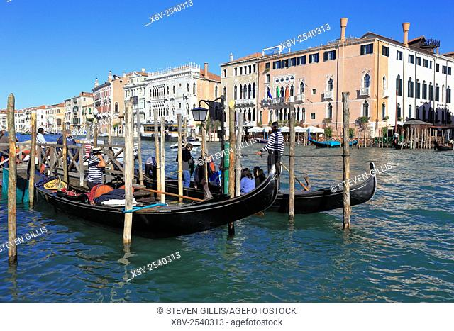 Tourists boarding a gondola on the Grand Canal, Venice, Italy