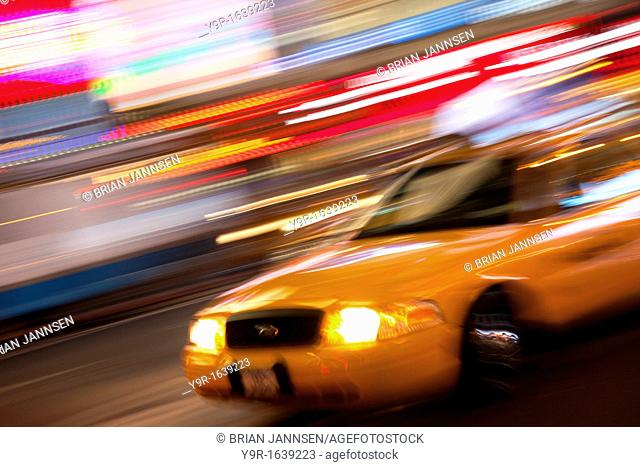 Taxi cab at night in Times Square, Manhattan, New York City, USA