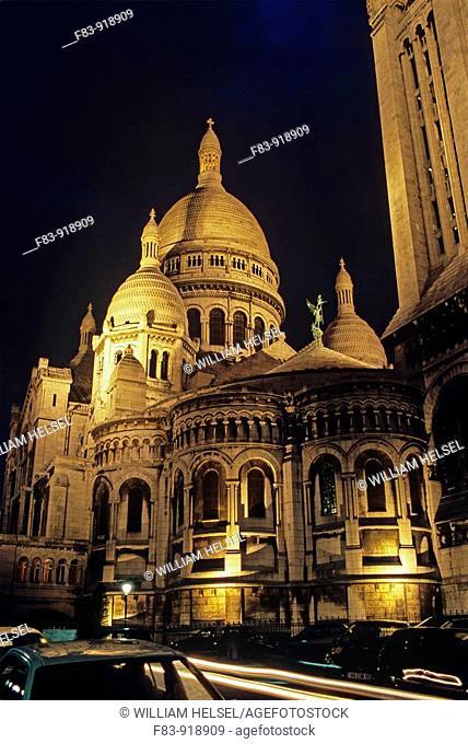 France, Paris, 18th arrondissement, Montmartre: Sacre-Coeur basilica, domes, bell tower on right, built 1875-1919, night