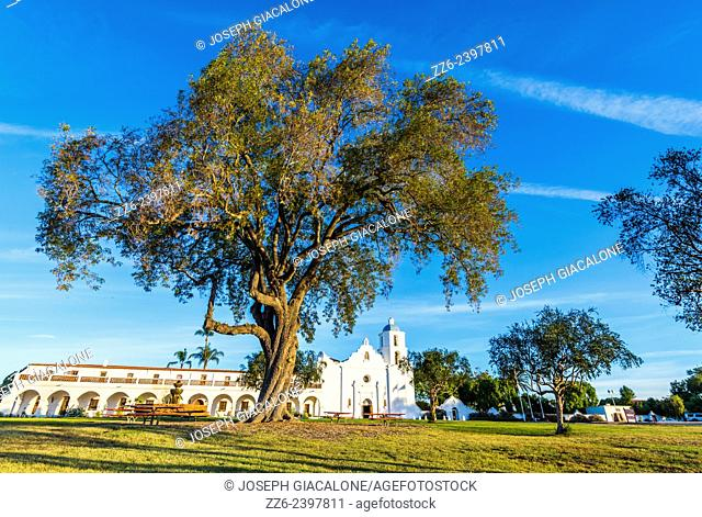 Trees and park area in front of the Mission San Luis Rey De Francia (founded 1798). Oceanside, California, United States