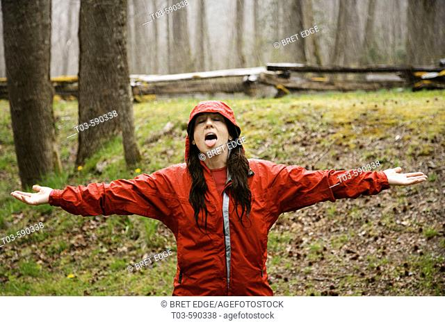 Female hiker makes the best of an April shower in Great Smoky Mountains National Park, Tennessee, USA