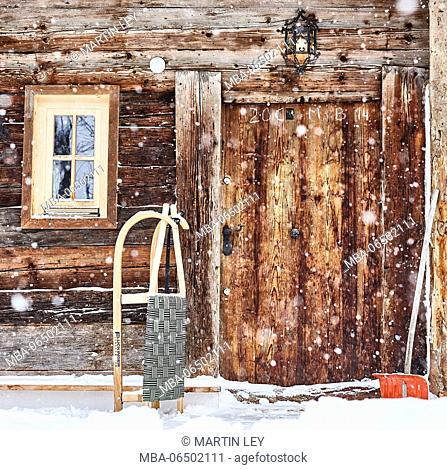old farm door, slides, snow shovel, snowfall