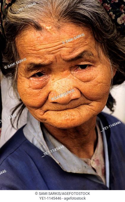 Portrait of a senior woman looking sad, Vietnam