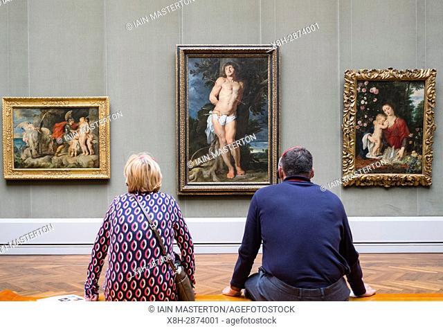 Couple looking at painting by Peter Paul Reubens , Der hl Sebastian at Gemaldegalerie in Berlin, Germany