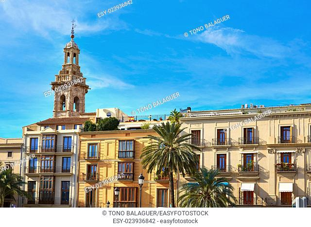 Valencia Plaza de la Reina square and Santa Catalina Church tower at Spain