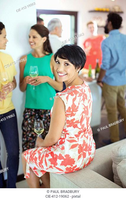Woman smiling on sofa at party