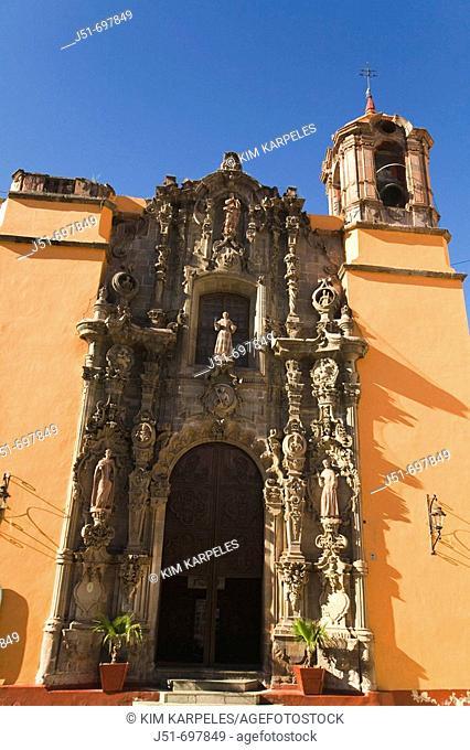 Exterior of Templo de San Diego church, baroque design, elaborately carved stone statues surrounding entrance, bell tower  Guanajuato, Mexico