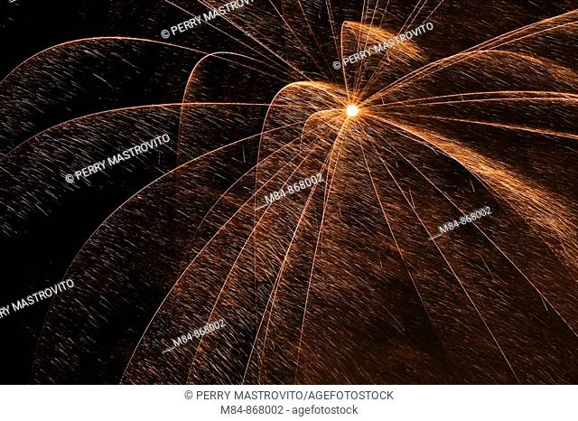 Gold and red fireworks in the night sky