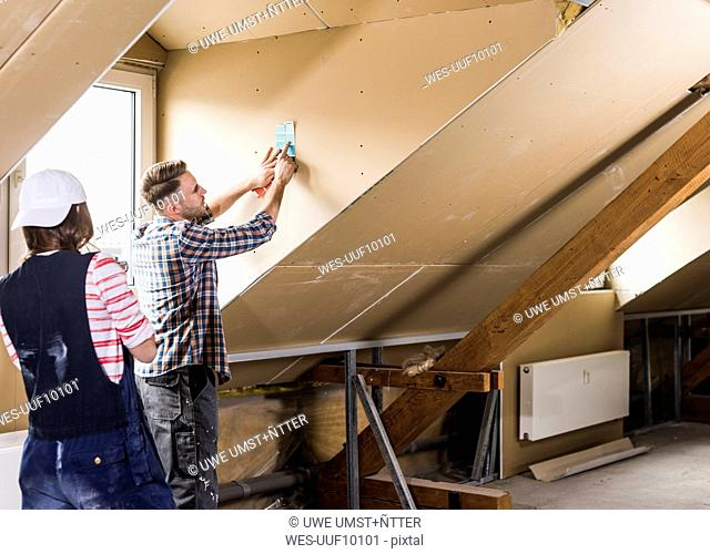 Young couple renovating their new home