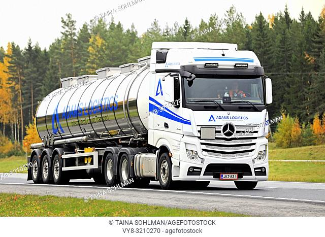 Salo, Finland - October 12, 2018: White Mercedes-Benz Actros 2548 semi tanker for liquid transport at speed on motorway on a day of autumn in Finland