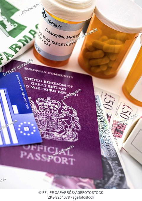 British passport and European health card along with several capsules, concept of medical price in the crisis of Brexit, conceptual image, vertical composition