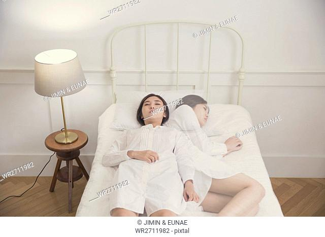Woman depressed lying down on bed