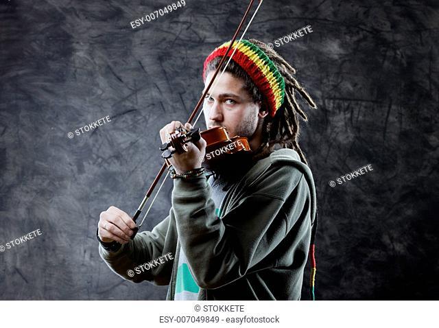 Rasta man musician playing violin