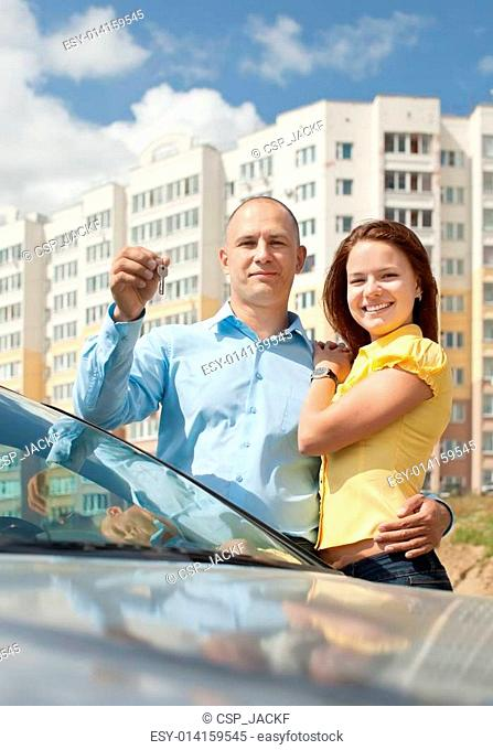 couple with key against new house