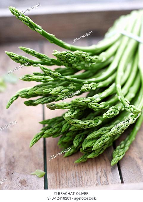 Green asparagus in a wooden box