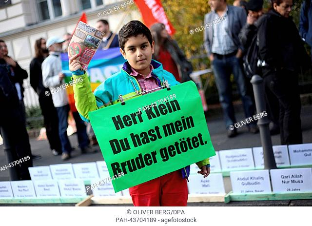 Demonstrators stand outside of the regional court in Bonn, Germany, 30 October 2013. The Bonn regional court has started taking evidence in the damages trial...