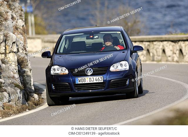 VW Volkswagen Golf GT 2.0 TDI, dark blue, model year 2005-, driving, diagonal from the front, frontal view, country road