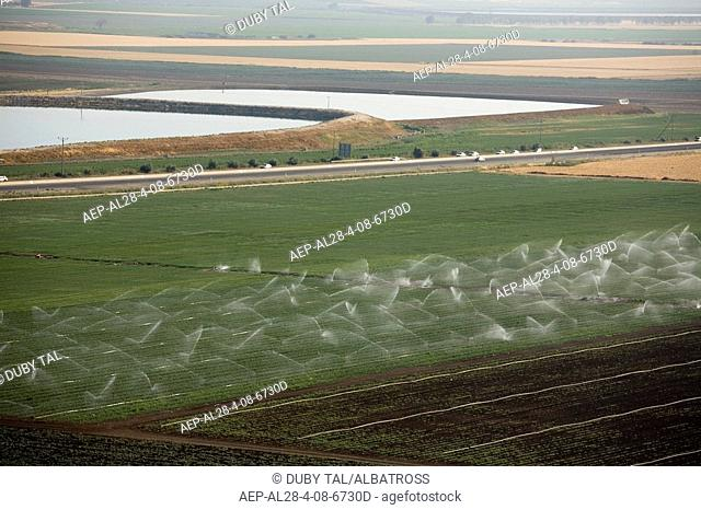 Aerial photograph of a green field in the Jezreel valley