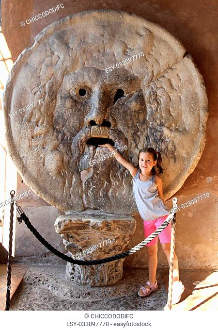 cheerful young girl puts her hand inside the Bocca della Verit?, Rome