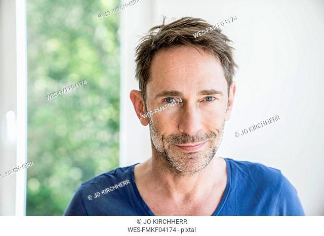 Portrait of smiling mature man with stubble