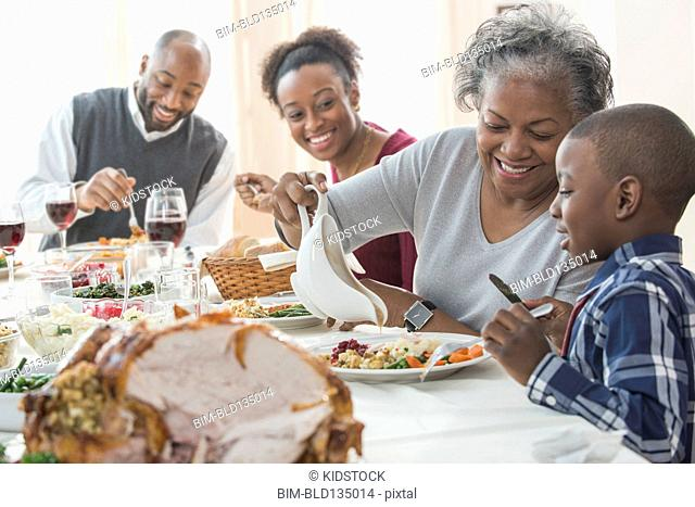 Family eating together at holiday table