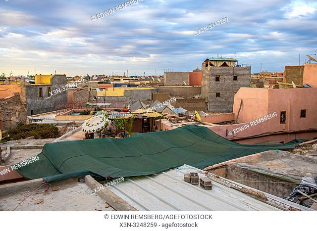 View from terrace overlooking the collection of buildings nestled close together in medina quarter of Marrakesh, Morocco