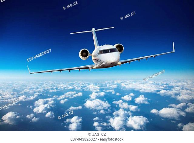 Luxury private jetliner flying above clouds. Modern and fastest mode of transportation, symbol of luxury and business traveling