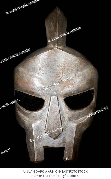 Gladiator helmet. Ancient roman gladiator reconstruction. Isolated over black