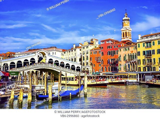Colorful Rialto Bridge Public Ferries Vaporetto Ferry Docks Gondola Tourists Grand Canal Venice Italy