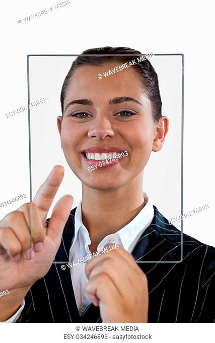Close up portrait of young businesswoman using glass interface