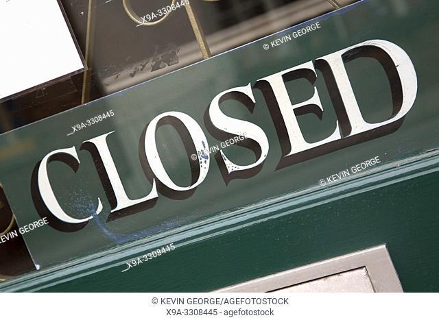 Closed Sign on Door Window