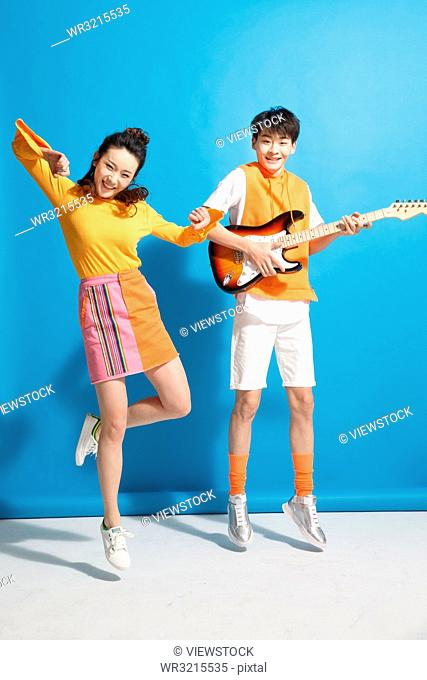 Young couples to play guitar and dance