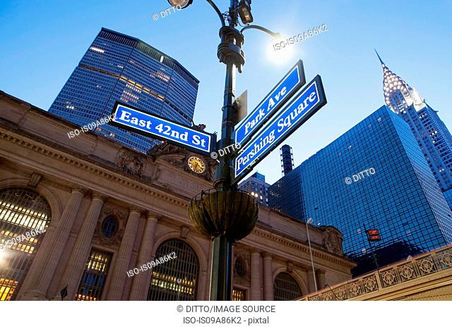 Street signs outside Grand Central station at dusk, New York City, USA