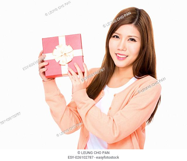 Young woman showing the red gift box