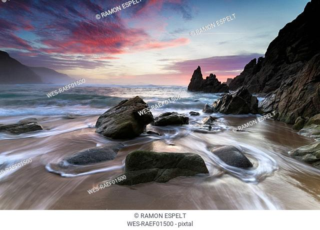 Spain, Galicia, Campelo beach at sunset in Valdovino