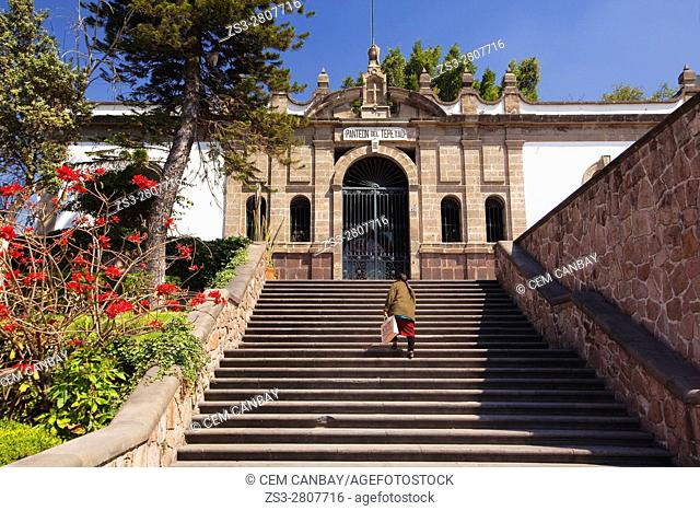 Indigenous woman climbing up the steps to Panteon del Tepeyac near the Old Basilica Our Lady of Guadalupe, Mexico City, Mexico, Central America