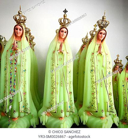Green sculptures of Our Lady of the Rosary for sale in a shop in Fatima, Portugal
