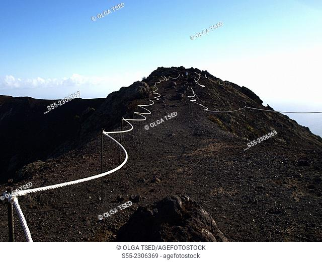 Narrow path around San Antonio volcano, Fuencaliente, La Palma, Canary Islands, Spain, Europe. White ropes lifted with a strong wind