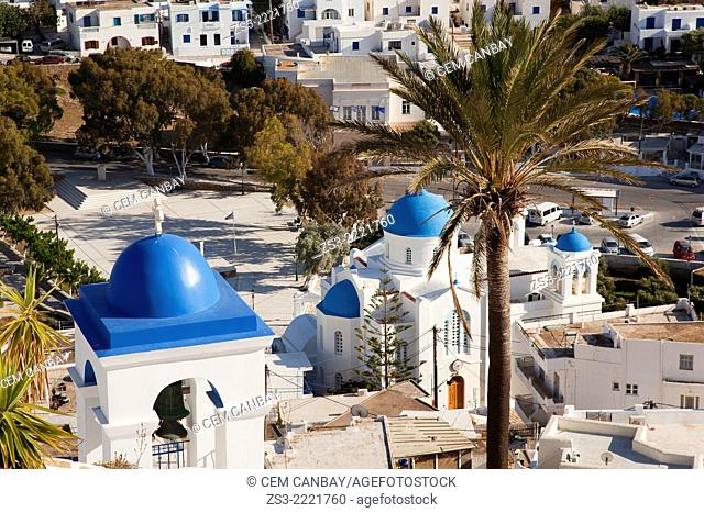 View from the top of the hill to the blue domed white Byzantine Greek Church of Panagia Gremiotissa and to the Cathedral in Chora, Ios, Cyclades Islands
