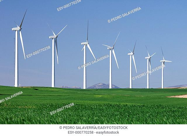 windmills in a field with blue and clear sky in Pozuelo de Aragon, Saragossa, Spain