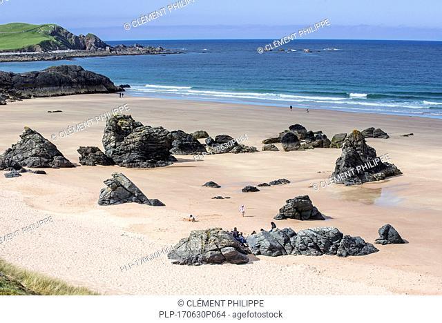 Sandy beach with rocks near Durness, Sutherland, Scottish Highlands, Scotland, UK
