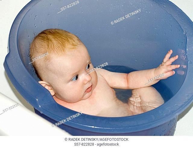 baby-girl in the bathing bucket