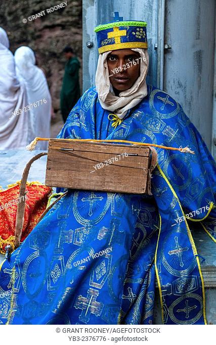 A Church Deacon Collecting Donations Outside Bete Medhane Alem Church, Lalibela, Ethiopia