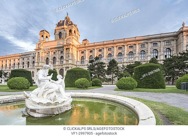 Vienna, Austria, Europe. Tritons and Naiads fountain on the Maria Theresa square with the Natural History Museum in the background