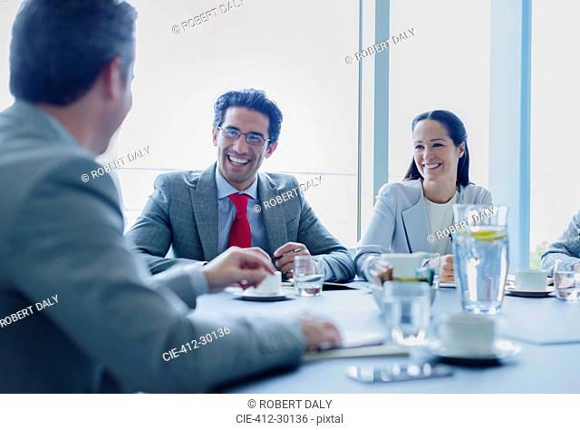 Smiling business people talking in conference room